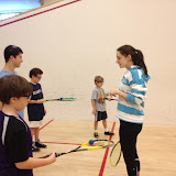 Players get instruction from Harvard Volunteer Laura Gemmell.  (Fall 2012 photo)