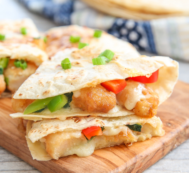 close-up photo of two Mandarin Orange Chicken Quesadillas stacked on each other
