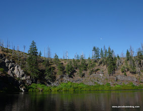 Photo: The south rim of the Blue Lake caldera; the shoreline vegetation is fed by springs that seep through the lava from the wet meadow in Corbett State Park.