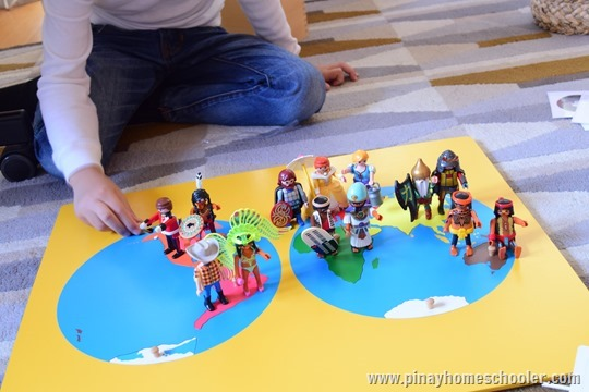 Playmobil Mini Figures on World Map