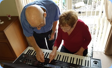 Dennis and Diane Lyons setting-up the Korg Pa4X.