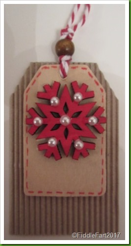 Red snowflake tag with pearl embellishment