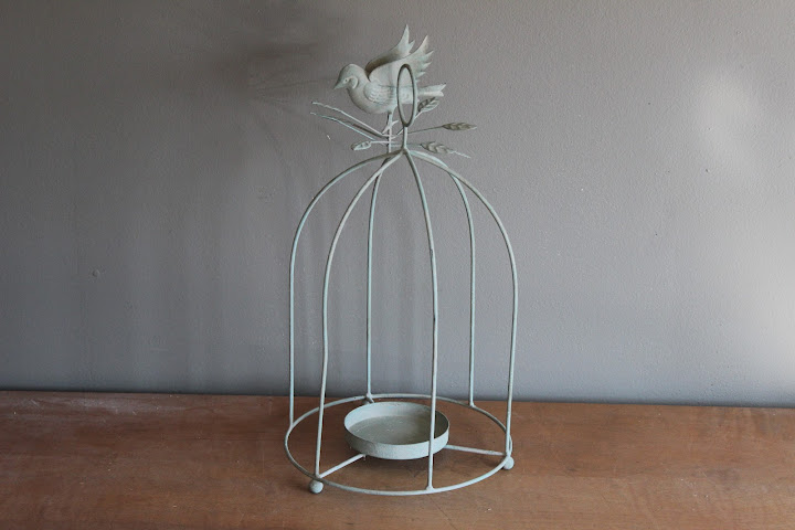Green birdcage pillar holder available for rent from www.momentarilyyours.com, $5.00.