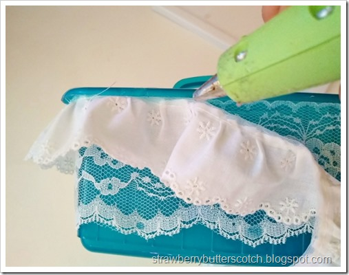 Gluing ruffled lace along the top edge of the caddy with a glue gun.  Careful, it's really hot.