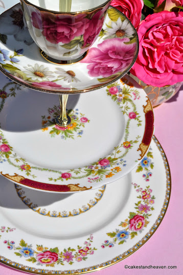 A unique vintage floral china cake stand