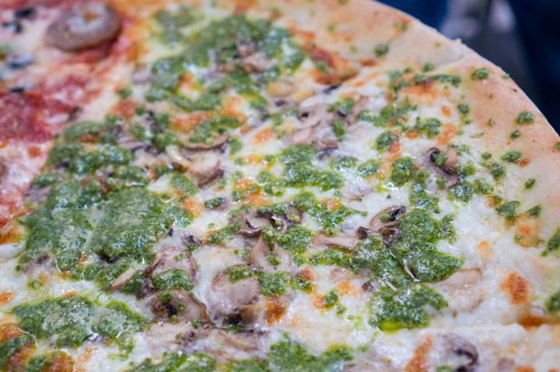 close-up photo of Pesto and Mushroom pizza