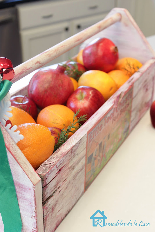 Oranges, apples, pomegranates inside toolbox- Christmas decor