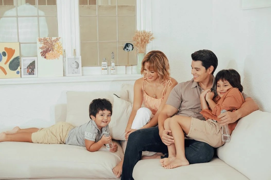 A happy family using Defensil Isopropyl Alcohol at home
