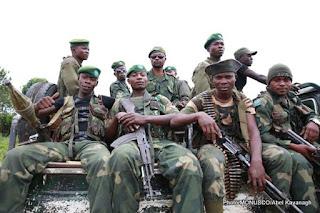 3 décembre 2014. Beni, Nord Kivu, RD Congo : Des soldats des Forces armées de la RD Congo en patrouille pour sécuriser la ville contre les attaques des groupes armés. Photo MONUSCO/Abel Kavanagh.