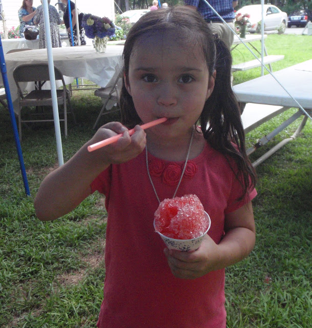 Juliana enjoys a snow-cone.