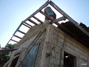 A man repairing a house roof