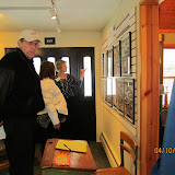 April 2016, Christy Forhan points out Our School History exhibit panel details.