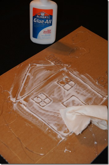 spread a thin coat of elmers liquid glue over entire piece of cardboard