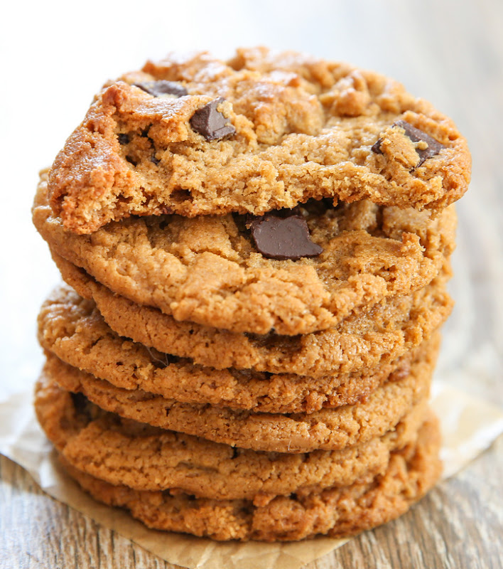 seven flourless almond butter cookies stacked on top of each other