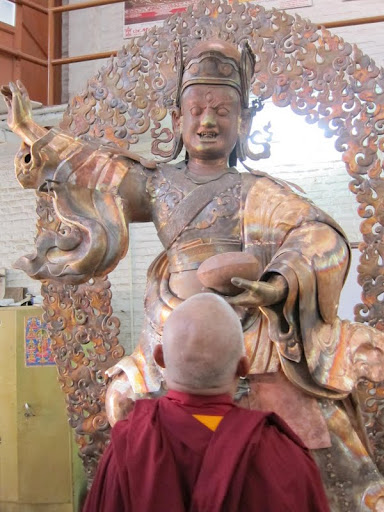 Lama Zopa Rinpoche checking the art of the Padmasambhava statues for Lawudo