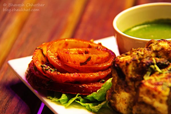 Onion Rings Served with Paneer Kali Miri Tikka at The Flying Saucer Sky Bar, Viman Nagar, Pune