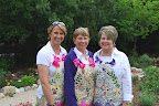 Gina Smith, Barbara Nuss and Dee Ann Rhodes, hostesses at the Makens garden.