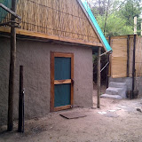 Our cabin, compost toilet and outdoor showers, during language week in Shakawe