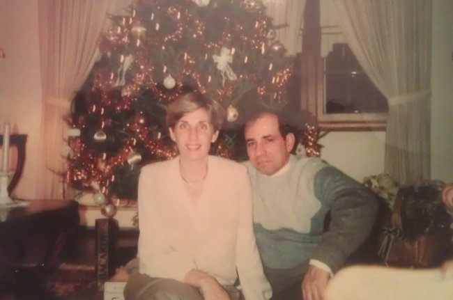 Mom and Dad in front of the fancy Christmas tree in the formal dining room.