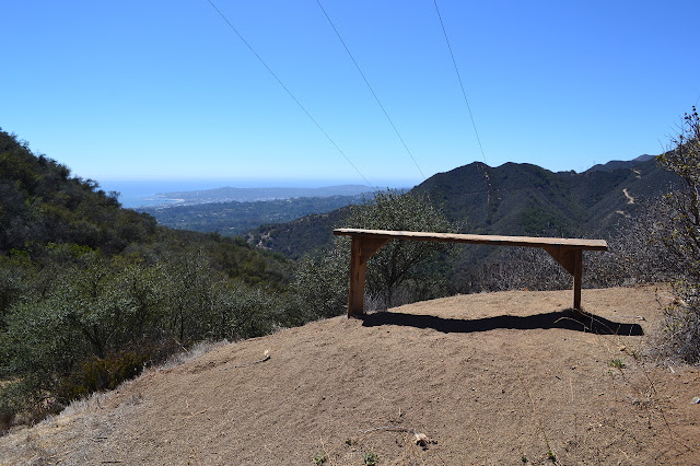 a bench without a back and with a view