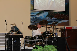 Charles, missionary to Ecuador, playing the drums and making 'loud' music for Jesus at WOPAC.
