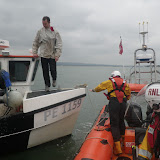 4 May 2012: An ILB crew member attaches a tow rope to a fishing vessel with mechanical problems in Poole Bay.  Photo: Dave Riley RNLI/Poole Lifeboat