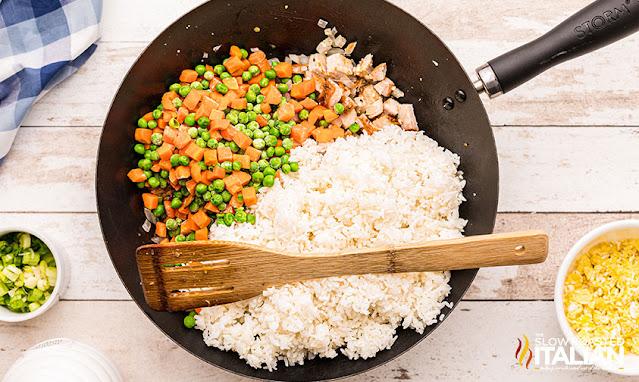 Rice, pork and veggies in wok