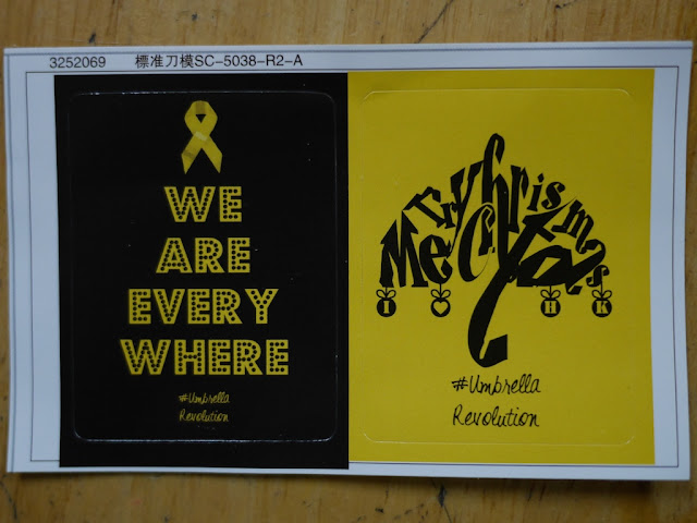 #UmbrellaRevolution stickers saying 'Merry Christmas' and 'We Are Everywhere'