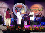 Dr. Yesudas hands over a gift to DR