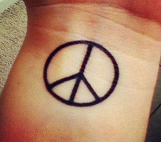 Peace sign tattoo just looking for placement  Pinterest