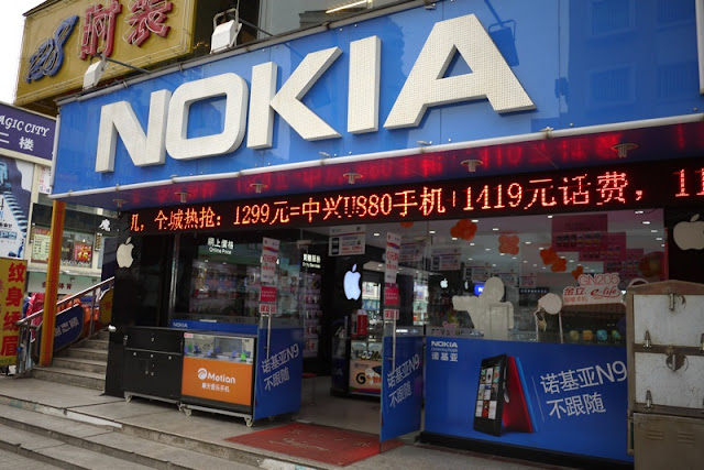 Store with large Nokia sign with displays for Apple and Motion