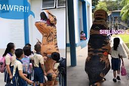 Viral Kakak Jemput Adik ke Sekolah Pakai Kostum T-Rex