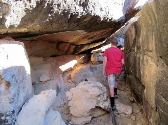 Exploring cracks between boulders