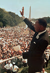 "In this Aug. 28, 1963 file photo, Dr. Martin Luther King Jr. acknowledges the crowd at the Lincoln Memorial for his ""I Have a Dream"" speech during the March on Washington. (AP Photo/File)"