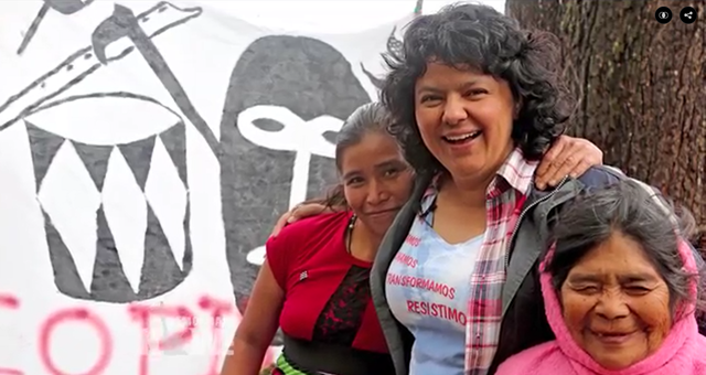 Berta Cáceres, one of the most well-known environmental and indigenous leaders in Honduras, with two indigenous women. The co-founder of the Council of Indigenous Peoples of Honduras (Copinh) was shot dead by gunmen who entered her home in La Esperanza at around 1am on Thursday, 3 March 2016. Photo: Democracy Now