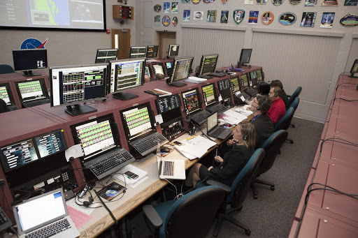 Members of the Launch Services Program team monitor systems on the United Launch Alliance Atlas V rocket from the Launch Vehicle Data Center.