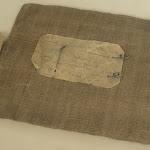 """Hôtel de la Porte : Musée du Barreau de Paris, sac en toile pour le rangement de dossier client (d'où l'expression """"l'affaire est dans le sac"""")"""