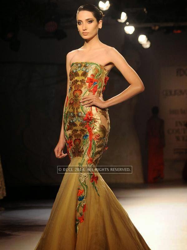 Kanika Dev walks the ramp for designer Gaurab Gupta on Day 3 of India Couture Week, 2014, held at Taj Palace hotel, New Delhi.<br />