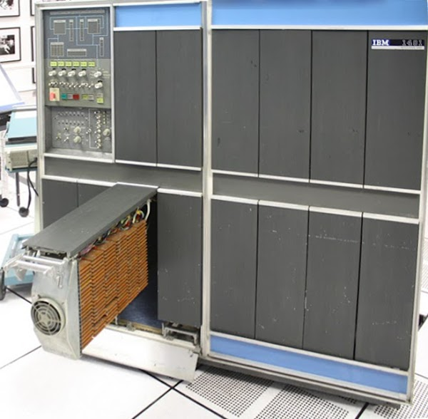 The IBM 1401 mainframe with gate 01B3 opened. This gate contains the arithmetic circuitry, made up of many SMS cards.