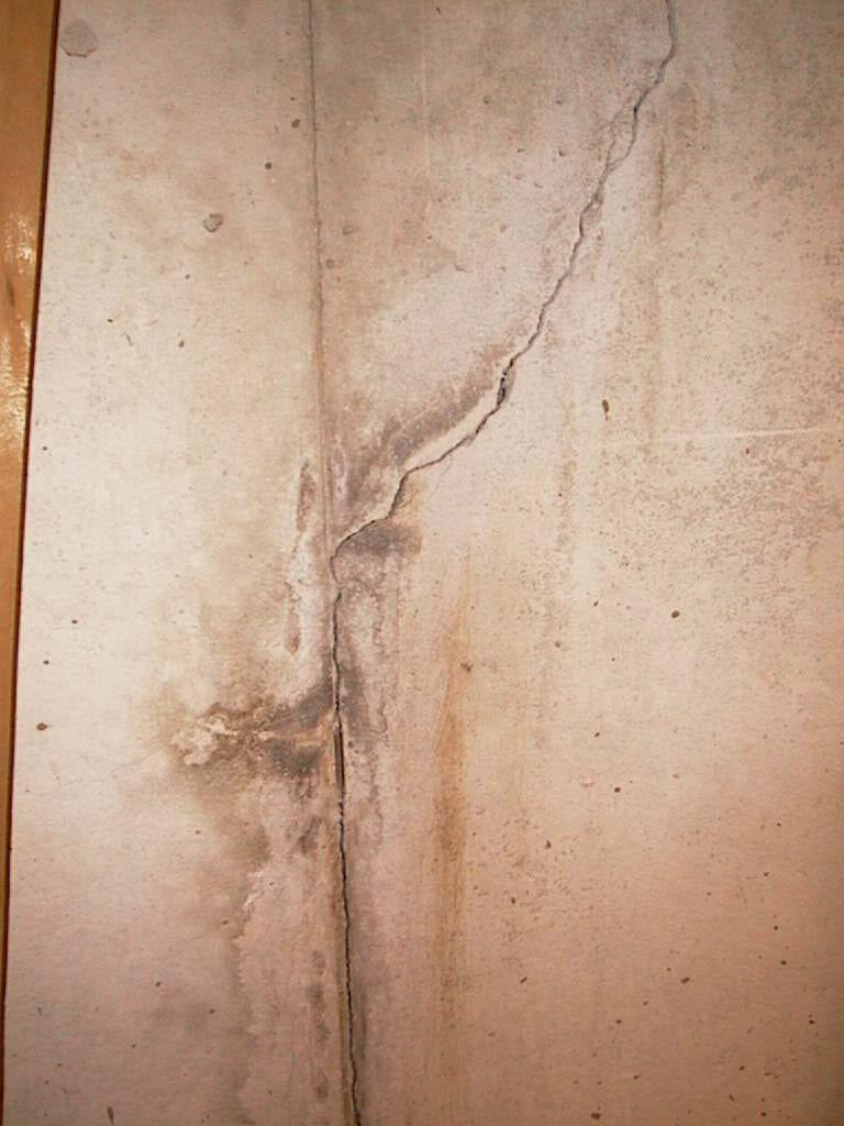 signs of a leaking basement crack are dirt trails down a wall and discolored concrete call jaco and get indianapolis best waterproofing contractor - Crack In Basement Wall