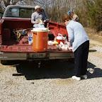 Linda prepares lunch while George waits.