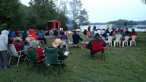 Music and testimonies by the camp fire before the Bible message.