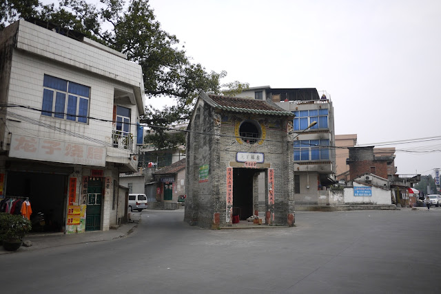 traditional older building isolated in the middle of an intersection