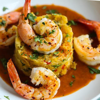 Mofongo Relleno (mashed plantains with shrimp and red pepper sauce).