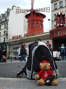 The bear again.  This time he's listening to his iPod outside the Moulin Rouge