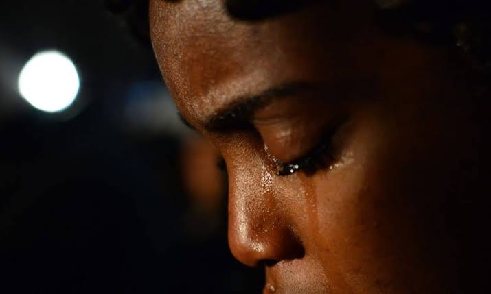 An African woman crying