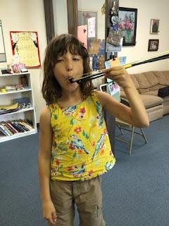 student uses violin bow like chopsticks