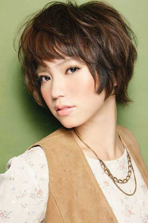 Korean trendy short hairstyles Short layered bob with bangs very perfect for wavy hair. Look simple and beautiful.