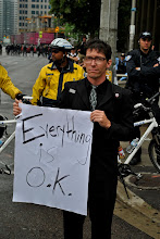 Photo: This gentleman seemed to be everywhere on Saturday, simply standing around and holding this eerie sign.
