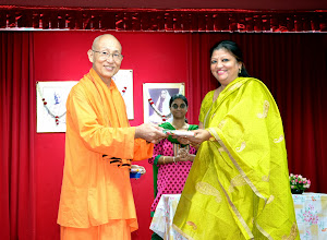 Photo: Mrs Suchitra Chandran, Reading mother coordinator, receiving a token of appreciation from Swamiji